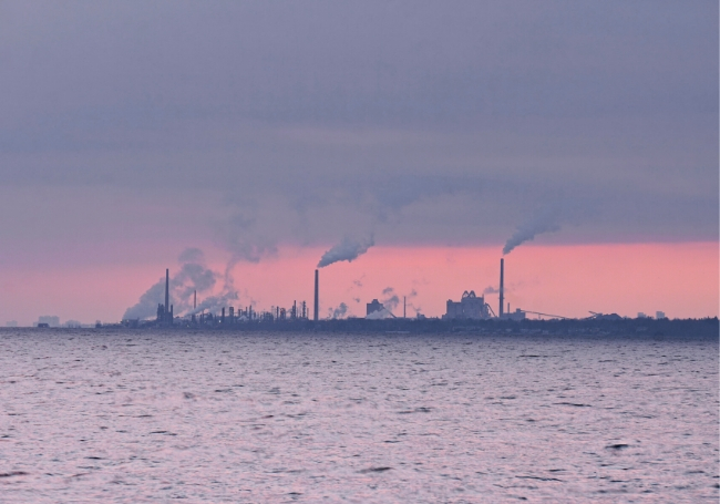 Emission of smoke on the horizon over Lake Ontario