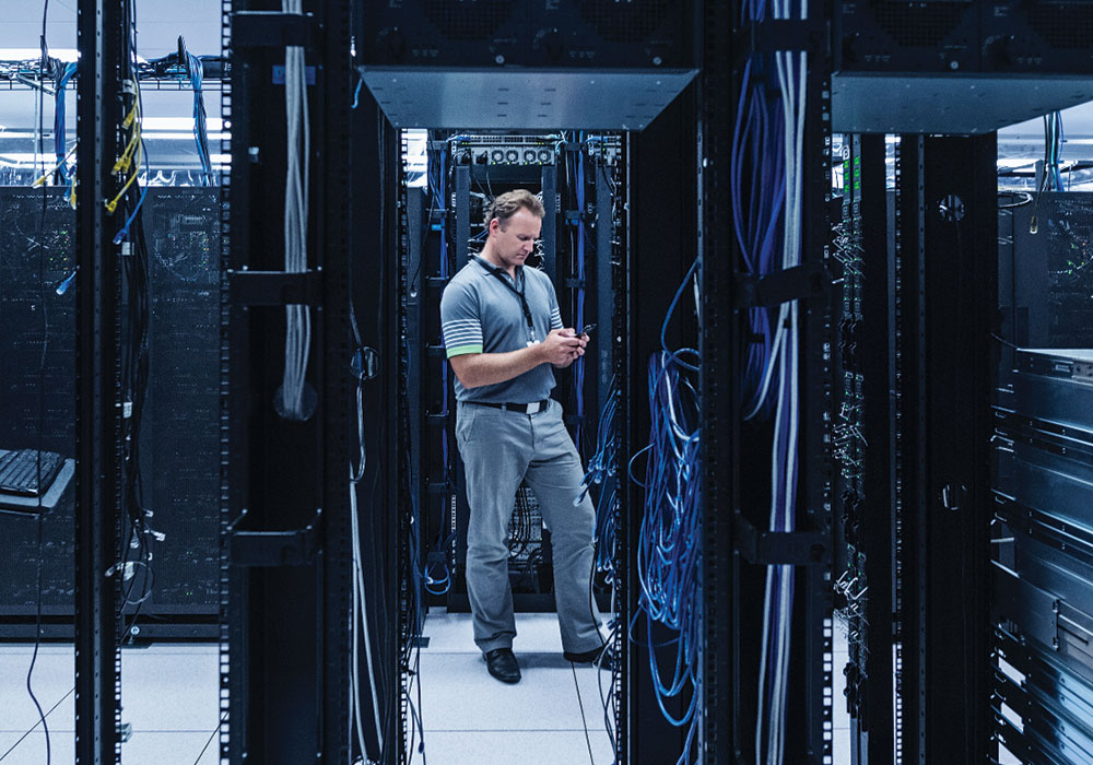 Data center employees analyze energy strategy