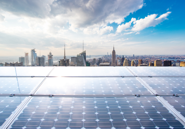 rooftop solar panels and city skyline